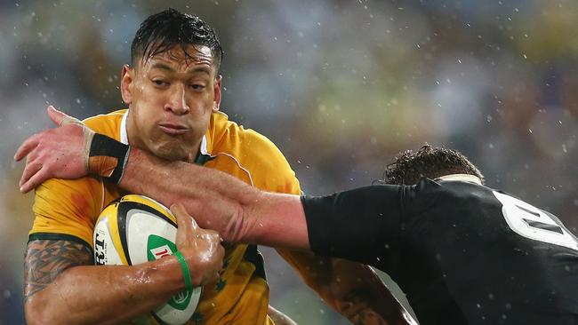 Israel Folau had a tough night in the slippery conditions.