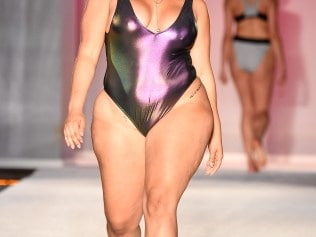 MIAMI BEACH, FL - JULY 22: A model walks the runway during SWIMMIAMI Sports Illustrated Swimsuit 2018 Collection at WET Deck at W South Beach on July 22, 2017 in Miami Beach, Florida. (Photo by Frazer Harrison/Getty Images for SWIMMIAMI)