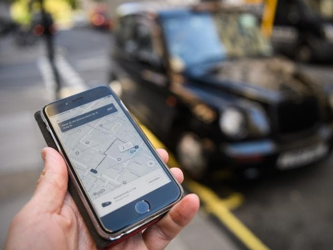 "LONDON, ENGLAND - SEPTEMBER 22:  In this Photo Illustration, a phone displays the Uber ride-hailing app on September 22, 2017 in London, England. The Transport Regulator has announced that it will not re-new the company's licence to operate in London as it's current service is ""not fit and proper"".  (Photo by Leon Neal/Getty Images)"