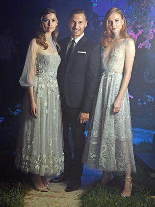 Paolo Sebastian with models Juliet Searle and Madison Stubbington, ahead of his Disney-inspired show for Adelaide Fashion Week at the Torrens Parade Ground. Picture: Tom Huntley