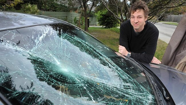 Stayner Street resident Julian Sadleir woke to find his car damaged by a gazebo which had blown across the road at Chelsea. Picture: Chris Eastman