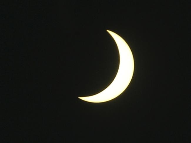 A partial solar eclipse is seen at Serangan village in Bali, Indonesia. Picture: AP