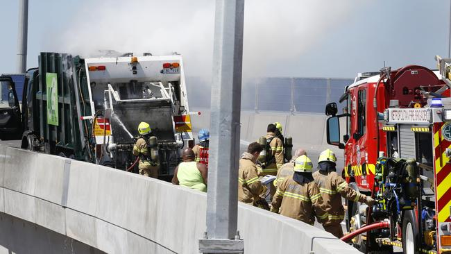 A garbage truck caught fire on the off ramp to the Bolte Bridge. Picture: David Caird