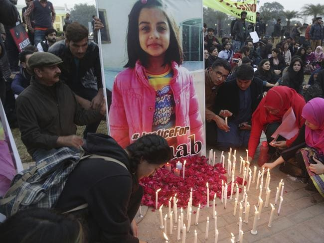 Pakistani students light candles during a protest rally to condemn the rape and killing of Zainab Ansari last week.