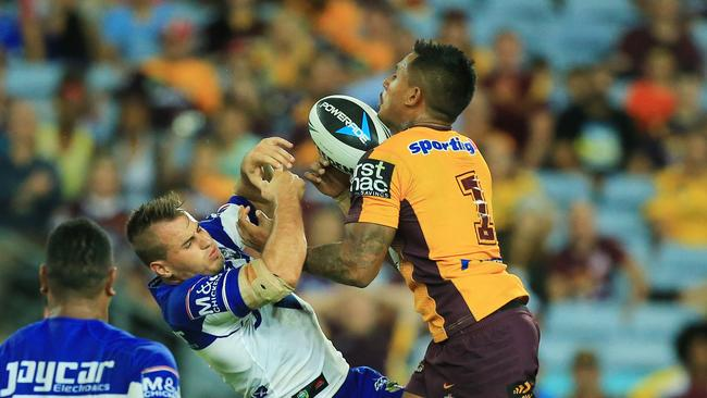 Josh Reynolds goes up for a high ball with Ben Barba.