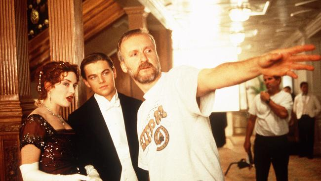 Director James Cameron with Kate Winslet and Leonardo DiCaprio during filming.