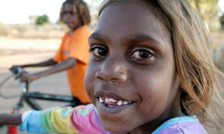 An aboriginal girl plays on her bike, Titjikala, near Alice Springs Northern Territory, Australia. Image shot 2005. Exact date unknown.