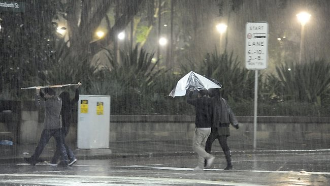 No umbrella? Hmmmm maybe some sort of sign could be utilised. Picture: Gordon Mccomiskie