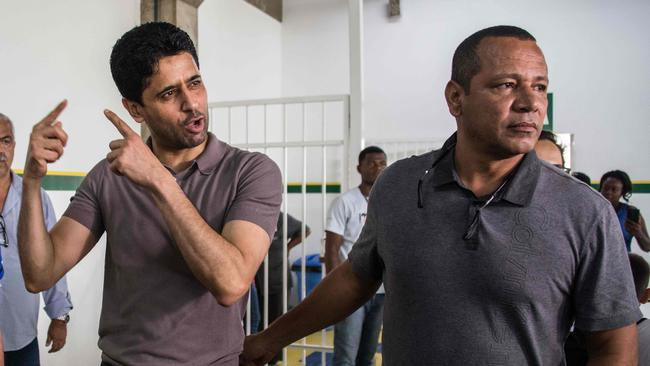 French football team Paris Saint-Germain's (PSG) Qatari president Nasser Al-Khelaifi (L) and Neymar Santos, father of Brazilian superstar and PSG's footballer Neymar Junior, are pictured at the Neymar Junior Institute project, in Praia Grande