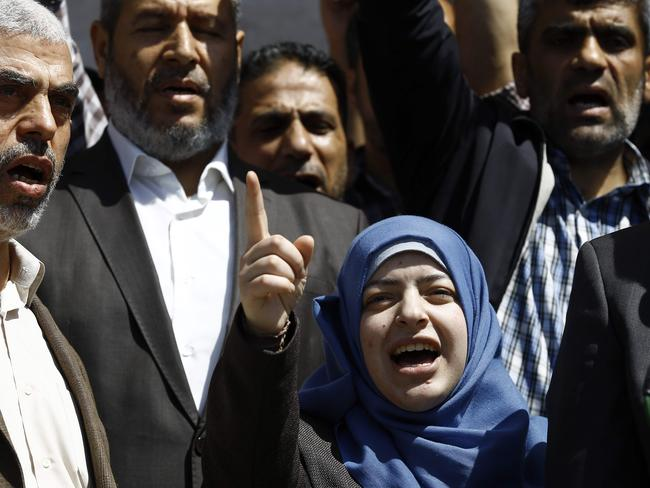Nahed Asida, the widow (C) of Mazen Faqha, speaks at a press conference in Gaza City. Picture: AFP