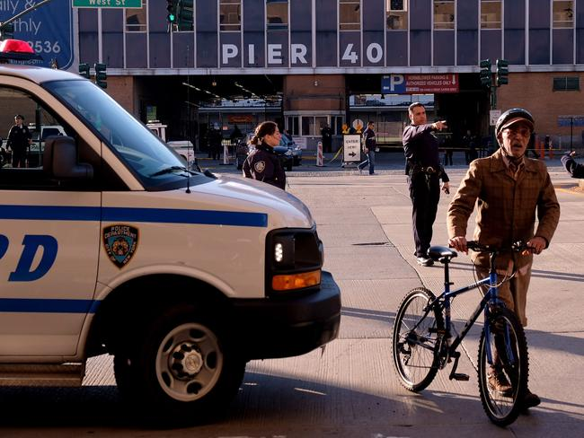 Police direct people away from the scene after reports of multiple people injured after a truck plowed through a bike path in lower Manhattan. Picture: Andy Kiss/Getty Images/AFP
