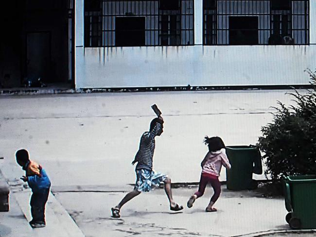 Shocking attack ... Security video shows a knife-wielding attacker going on a rampage at a Chinese primary school in Macheng, central China's province of Hubei.