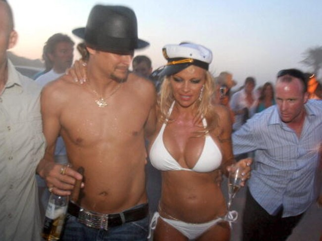 Pamela Anderson shares a drink with her husband, US musician Kid Rock on their wedding day in Saint-Tropez, southern France.
