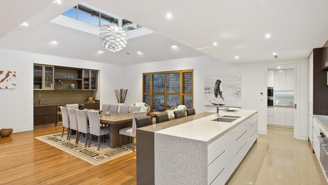 The ceiling above the dining room was designed to let natural light in.