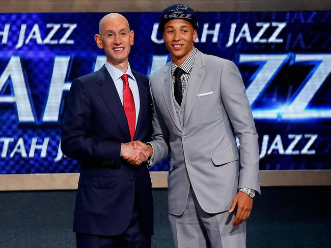 Dante Exum shakes hands with NBA Commissioner Adam Silver after being selected by the Utah Jazz