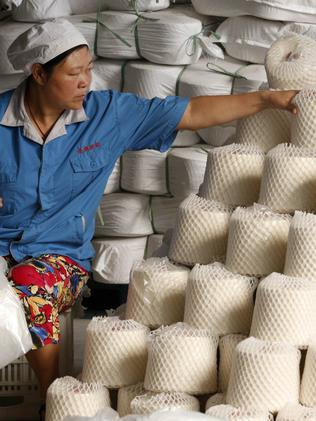 A worker at a textile factory in Huaibei. Pic: AFP.