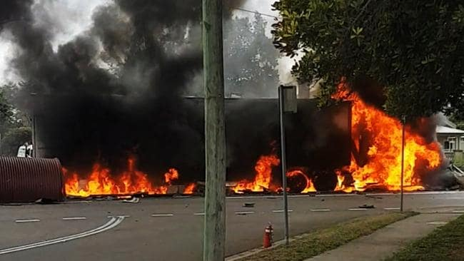 The truck smashed into several parked cars and a building before exploding into flames in Singleton on Wednesday. Picture: Tina Saunders