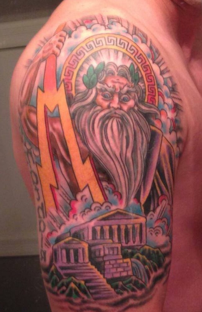 Heavily inked ...Justin Cosma shows off his Zeus tattoo on Facebook.
