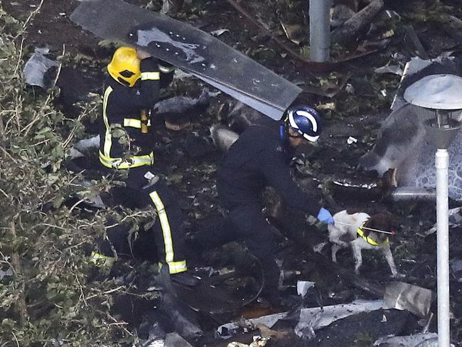 Firemen search the debris around Grenfell Tower in London. Picture: AP Photo/Frank Augstein