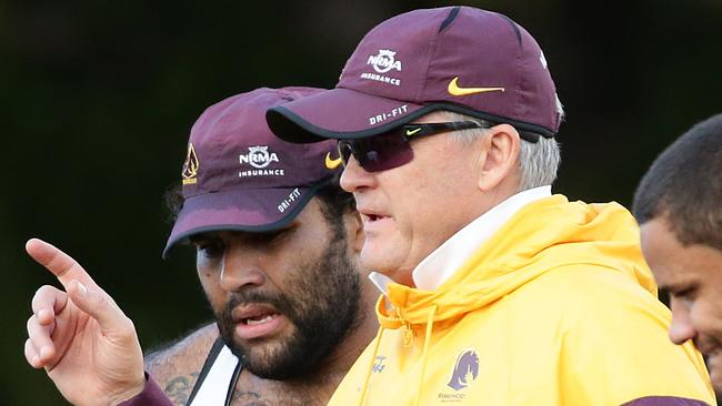 Sam Thaiday taking instruction from Anthony Griffin.