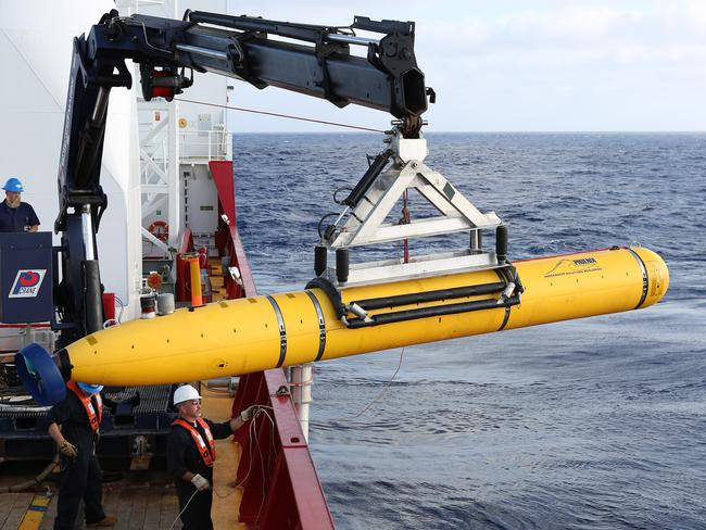 Underwater vehicle Bluefin-21 is craned over the side of Australian defence vessel  <i>Ocean Shield </i>in the search for missing Malaysia Airlines flight MH370 on April 14. Picture: Lieutenant Kelli Lunt/Australia Department of Defence/Getty Images
