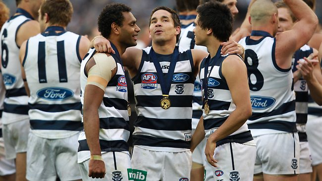 SSS Pub date: 14/04/2013 Page: 88 - 01/10/2011 NEWS: 2011 Grand Final. Geelong v Collingwood. MCG. Geelong Aboriginal players Travis Varcoe, Mathew Stokes and Allen Christensen celebrate together after the win. Pic. David Caird F16995950