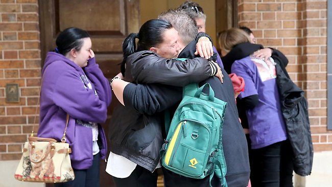 Supporters of Kiesha hug outside court after the six-year-old's mother Kristi Anne Abrahams was sentenced to 16 years none parole in the Supreme court for murdering her daughter. Picture: John Grainger