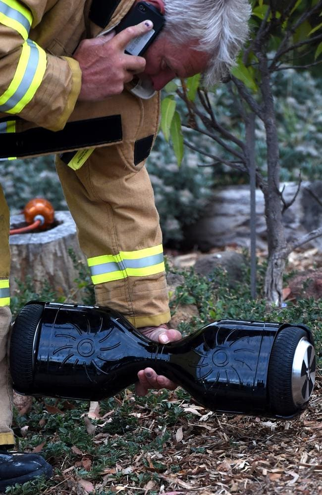 A MFB fire officer with another hoverboard at the property. Picture: Nicole Garmston