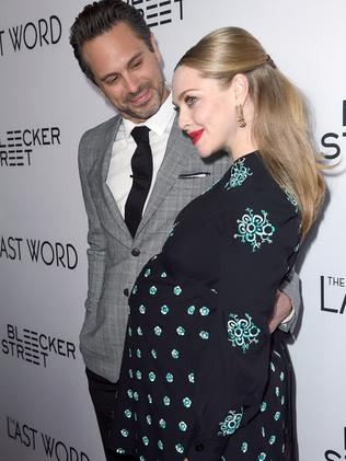 Thomas Sadoski (L) and pregnant fiancee Amanda Seyfried. Picture: Getty