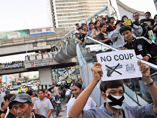 We won't be silenced ... protesters gather at an anti-coup rally in Bangkok, Thailand.