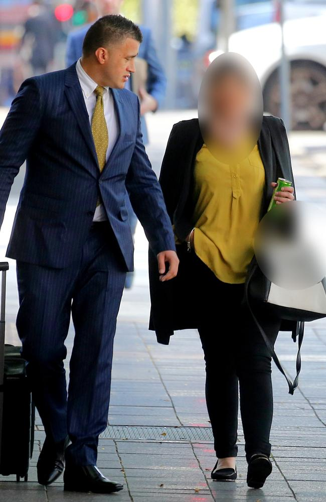 The 17-year-old, who cannot be identified for legal reasons, entering Parramatta Children's Court with her lawyer, Zemarai Khatiz. Picture: John Grainger.