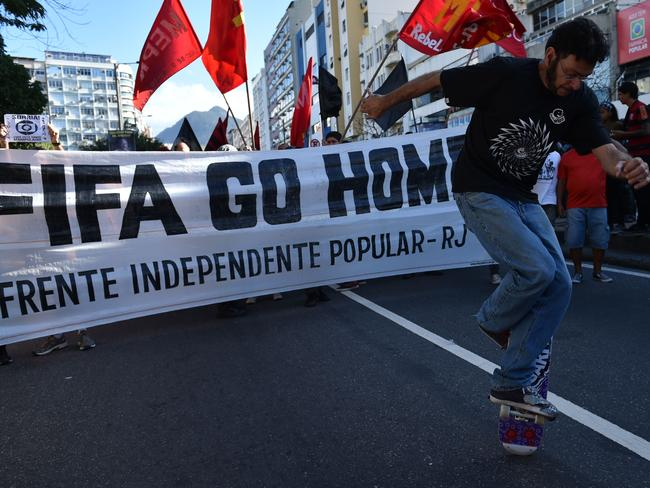 Demonstrators protest against the FIFA World Cup.