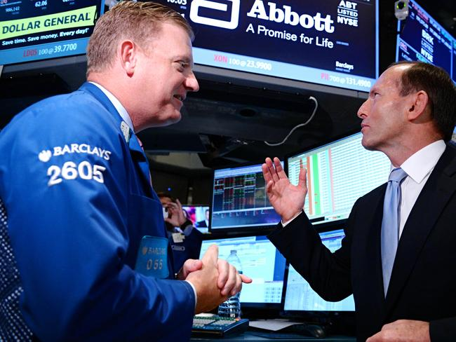 Trading places... Mr Abbott speaks with a trader at the New York Stock Exchange. Picture: Jake Nowakowski