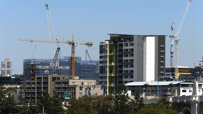 Cranes on high-rise apartment buildings in South Brisbane.