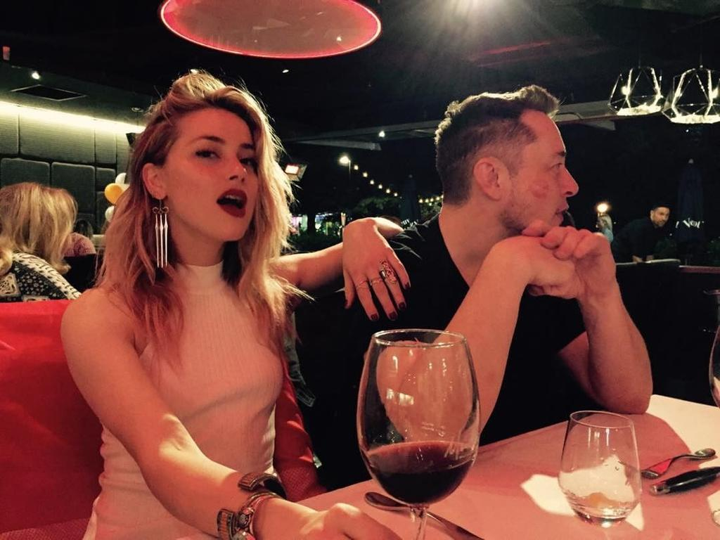 """Amber Heard rings in her birthday with Elon Musk at Moo Moos Bar and Grill in the Gold Coast ... """"Cheeky"""" Picture: @amberheard/Instagram"""