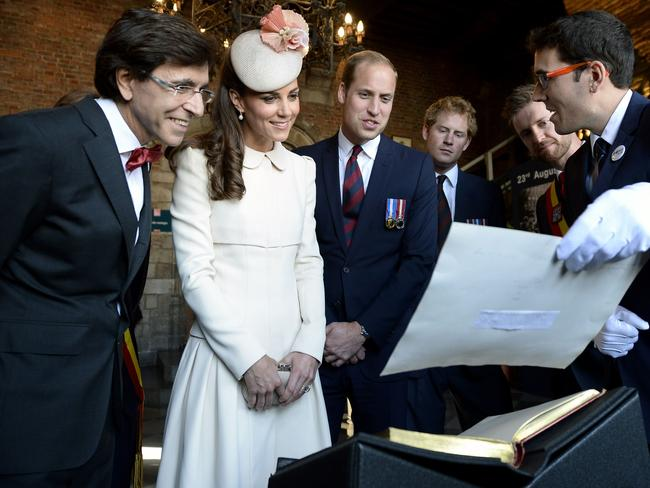 Outgoing Belgian Prime Minister Elio Di Rupo, Duchess of Cambridge Catherine, Britain's Prince William, and Britain's Prince Harry are seen at Mons' city hall during commemorations marking 100 years since the invasion of Belgium by Germany at the start of World War I. AFP PHOTO / BELGA / DIRK WAEM