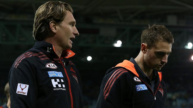 James Hird with captain Jobe Watson after the loss. Picture: George Salpigtidis