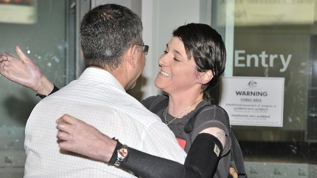 RETURN: Ultramarathon burns victim Kate Sanderson is greeted at Perth Airport by her brother Ian Sanderson ahead of the Parliamentary which starts tomorrow. Picture: Kerris Berrington