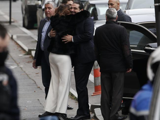 An unidentified woman hugs Lebanon's Prime Minister Saad Hariri as he arrives at his residence, in Paris, Saturday, Nov. 18, 2017. Picture: AP.