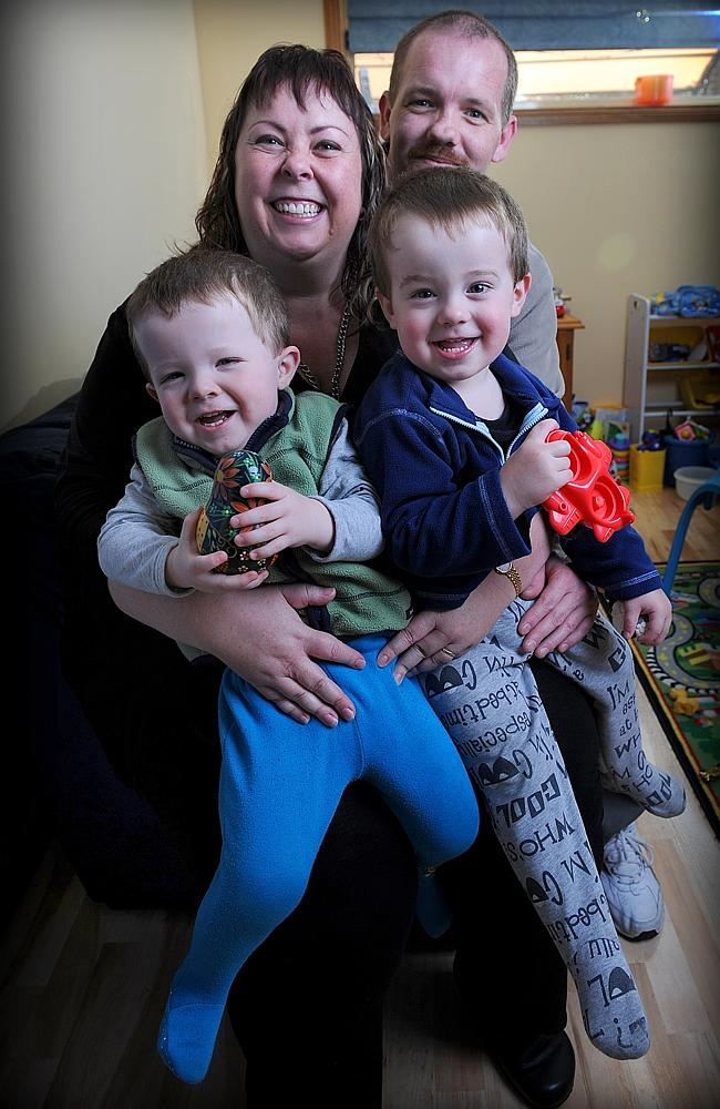 Joy of parenthood ... Lisa and Nik Romanoff with their twin sons Taj and Alex who were born by surrogacy in India.