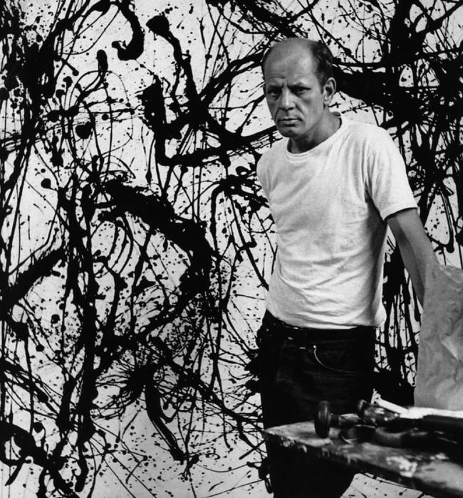 Artist Jackson Pollock in front of one of his artworks at the Museum of Modern Art, New York, in 1950.