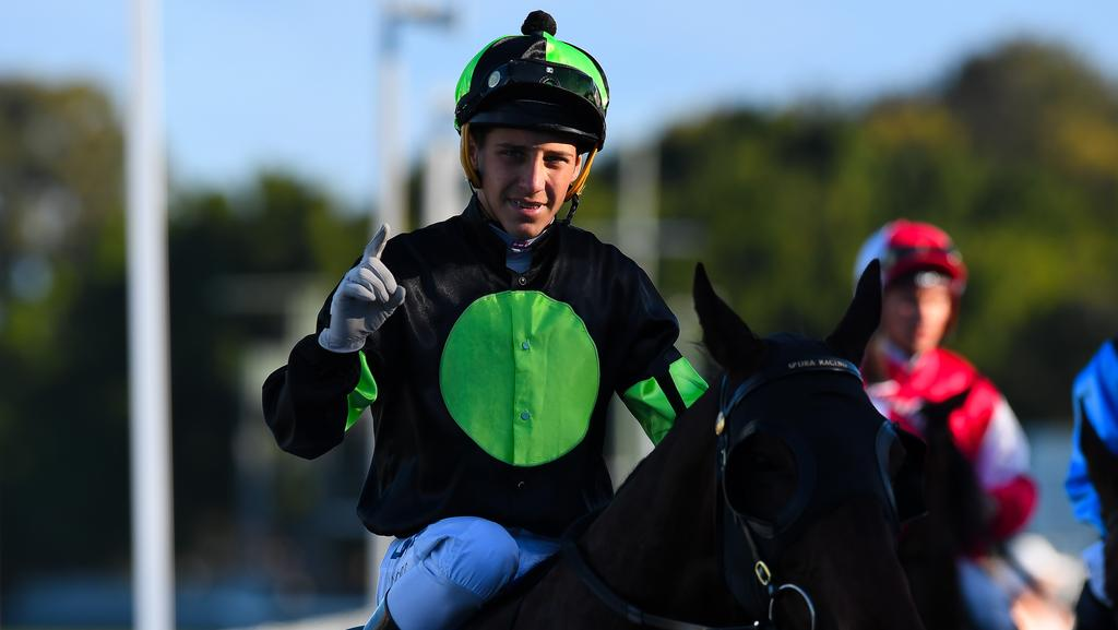 Jockey Jag Guthmann-Chester gestures after riding Lothario to win race 8, the CNW Electrical Wholesale Class 6 Handicap during the CNW Raceday at Aquis Park in the Gold Coast. Photo: Albert perez, AAP.