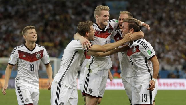 Germany's Mario Goetze (19) celebrates with teammates.