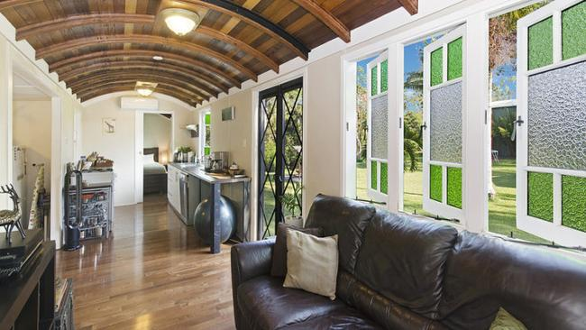 Step inside the former train carriage at Alligator Creek near Townsville. Picture: realestate.com.au