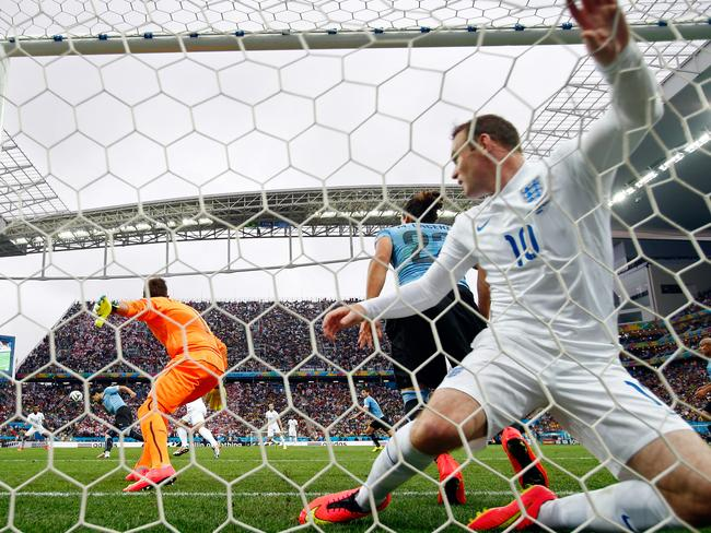 England's Wayne Rooney falls into the goal after his earlier miss from half a yard out.