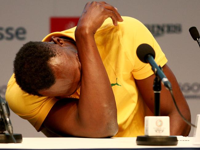 Usain Bolt reacts to a question at his first press conference in Glasgow.
