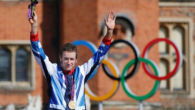 Britain's Bradley Wiggins celebrates in the forecourt of Hampton Court Palace after winning the men's individual time trial Picture: EPA