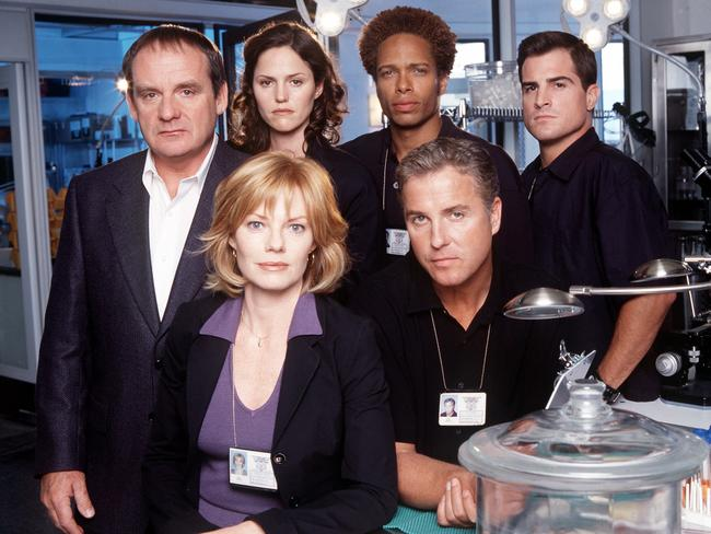 Paul Guilfoyle, left, with CSI cast members Marg Helgenberger and William Petersen (front) and (back) Jorja Fox, Gary Dourdan and George Eads.