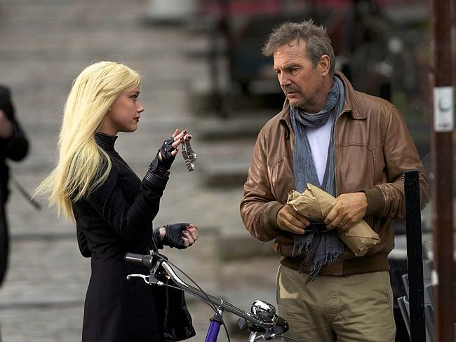 Why am I in this movie ... Amber Heard as Vivi Delay with Kevin Costner (Ethan Renner) in 3 Days to Kill. (AP Photo/Relativity Media, Julian Torres)