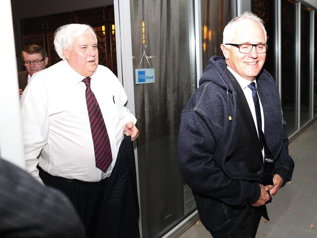 Close ... Clive Palmer and Malcolm Turnbull are Canberra's hottest couple at the moment.